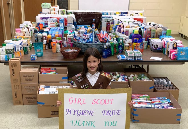 Sophia Lipp of Oconto is seen with the more than 6,400 products that were donated as part of her Girl Scout Global Action Hygiene Drive in August. The items will be distributed by Bread by the Bay food pantry.