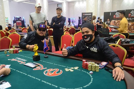 Joshua Chargualaf, right, of Inarajan beat Rico Meno for the Monster Stack 2 title at the Asian Poker Tour Philippines II 2019 held at Resorts World Manila Sept. 11-22.