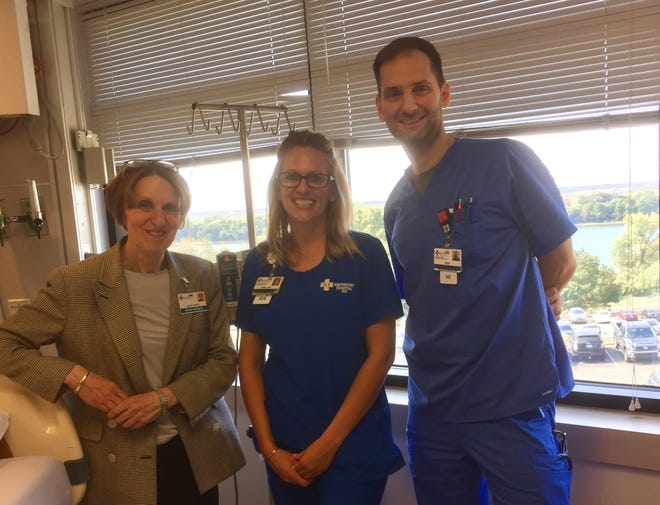 New Methodist Health CEO Linda White, left, poses with Registered Nurse Erin Corpe and Ben Henshaw, a nurse extern, in the Methodist Intensive Care Unite.