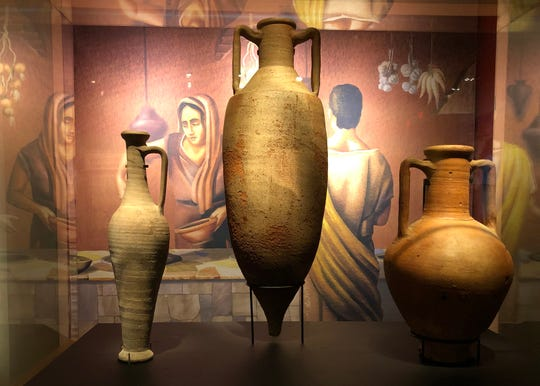 These amphorae — ceramic vessels that once held, from left, garum (a fermented fish sauce used as a condiment that was a specialty of Pompeii, wine and oil — miraculously survived the eruption of Mount Vesuvius, unlike their former owners.