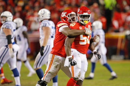 Justin Houston (50) celebrates one of his two sacks against the Colts in last year's AFC playoffs.
