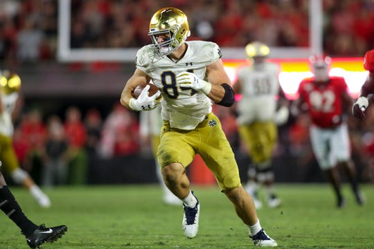 Notre Dame Fighting Irish tight end Cole Kmet (84) runs after a catch against the Georgia Bulldogs in the fourth quarter at Sanford Stadium.
