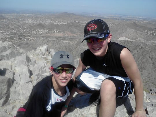 Future Notre Dame baseball teammates Cole (right) and Casey Kmet pose during a family vacation in Arizona