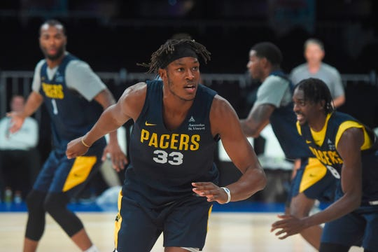 Indiana Pacers player Myles Turner (C) trains during the training session at the NSCI Dome in Mumbai on October 3, 2019. - Stars from the Sacramento Kings and Indiana Pacers will play pre-season games in Mumbai on October 4 and 5 to boost a desperate campaign to improve the sport's popularity in South Asia.
