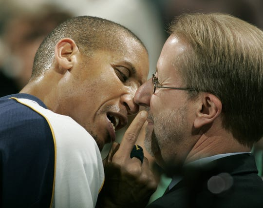 FILE --  Reggie Miller and media relations David Benner take part in their pregame ritual, where Reggie screams at Benner nose-to-nose for about 3-4 minutes.