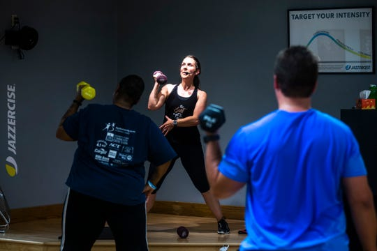 Iowa City Council candidate Laura Bergus leads a 5:30 a.m. Jazzercise class, Thursday, Oct., 3, 2019, at a Jazzercise Fitness Center in Iowa City, Iowa.