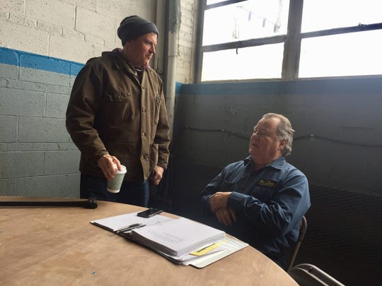 "Writer/Director Robert Jury (left) and actor Peter Gerety (right) on the set of ""Working Man."""