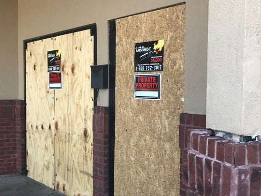 Arson tip posters and 'No Trespassing' signs are posted on the boarded doors of Elite Bar & Grill on 45 Broadview Drive in Jackson, Tenn. on Oct. 3, 2019 following a fatal shooting that occurred there on Sept. 21.