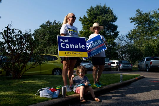 Caitlin Motte and Jennifer Prest stand outside theMemphis Botanic Garden to encourage voters to go out and vote and support candidate City Council Ford Canale and Morgan Worth in Memphis, Tenn., Thursday, Oct. 3, 2019. Caitlin Motte's son, Sutter, 3, sits outside along side with her with his tablet.