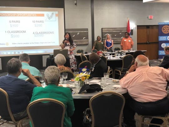 Kristi Turnbow, a member of Downtown Jack Rotary Club, tells members how they can donate to Rotary Heart & Sole, a fundraiser to donate shoes to JMCSS students through Samaritan's Feet. Counselors from Andrew Jackson, Arlington and Alexander shared stories about the need of shoes in their schools.