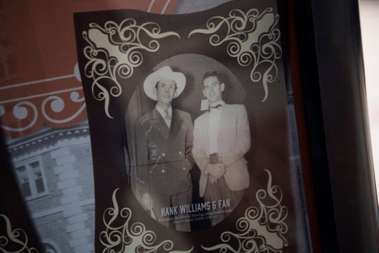 A photo of Hank Williams Sr. is seen outside the Andrew Johnson building in downtown Knoxville on Sept. 25, 2019. Country singer Hank Williams checked into and out of the hotel on New Year's Eve 1952, his last night alive.