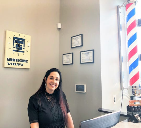 Bombshells Salon and Bruce's Barber Shop owner Kara Koontz. The clock behind the counter was found while Koontz was clearing out her grandfather's old school bus garage.