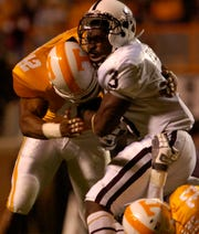 Tennessee special teams player LaMarcus Thompson lays a hard lick on Mississippi State kick returner Derek Pegues in the 2008 game at Neyland Stadium. The Tennessee defense led the way to a 34-3 win over the Bulldogs.