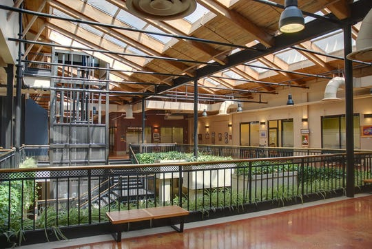 The indoor atrium at Cherokee Mills office park, located on Sutherland Ave.