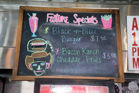 A specials board with a sketch of Hank Williams is seen at the Burger Bar in Bristol, Va., on Sept. 25, 2019. Driver Charlie Carr stopped here in the early morning hours of New Year's Day 1953 as he drove Williams to a show in Canton, Ohio. Williams never made the show and might already have been dead before he reached Bristol.