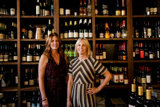 Marla Milner, left, and Michelle Wise, right, co-owners of The Cellar Wine Bistro, poses for a photo, Wednesday, Oct. 2, 2019, in West Lafayette.