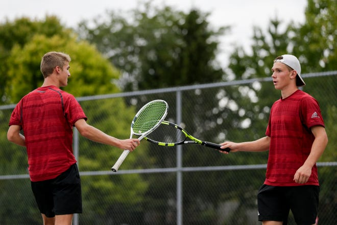 McCutcheon's Gavin Dardeen, left, and John Shambaugh tap rackets during the No. 1 doubles match of the IHSAA boys sectional 56, Wednesday, Oct. 2, 2019 West Lafayette Elementary School in West Lafayette.