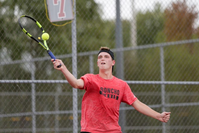 Lafayette Jeff's Avery Beaver returns the ball during the No. 1 singles match of the IHSAA boys sectional 56, Wednesday, Oct. 2, 2019 West Lafayette Elementary School in West Lafayette.