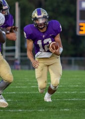 Quarterback Kyle Lutz leads a run-oriented Fowlerville offense.