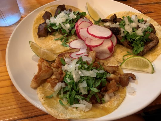 A chicken taco, steak taco and lengua taco at Victoria Mexican Restaurant.