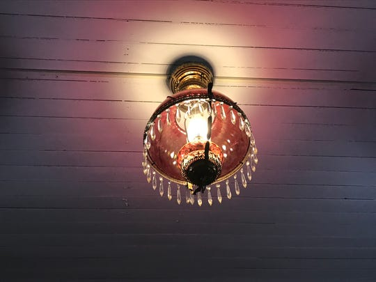 A period light fixture hanging from the ceiling in the Grand Army of the Republic, Michigan Department James B. Brainerd Post #111 Memorial Hall and Museum, at 224 S. Main St. in Eaton Rapids, built in 1886.