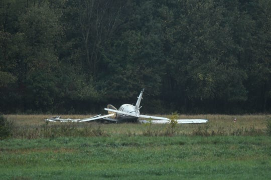 The scene just west of Capital Region International Airport where a small plane crashed Thursday morning, Oct. 3, 2019.  Three are dead, three were taken to Sparrow hospital in Lansing with critical injuries.  [AP Photo/Matthew Dae Smith/Lansing State Journal]