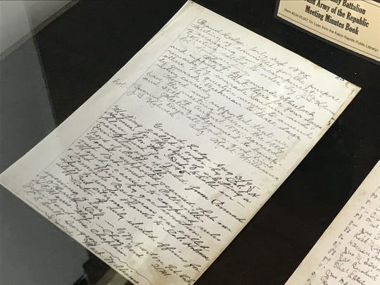 Meeting minutes in a display case at the Grand Army of the Republic, Michigan Department James B. Brainerd Post #111 Memorial Hall and Museum in Eaton Rapids.