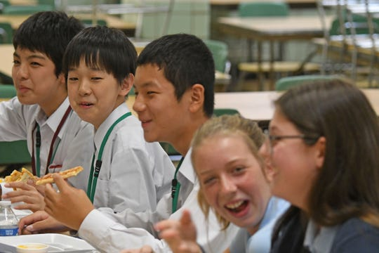 Visiting students from Japan shared laughs and pizza with students from St. Peter's on Thursday morning.