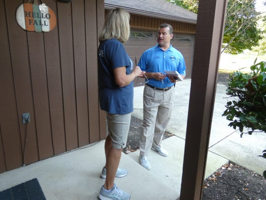 Marion Mayor Scott Schertzer, who is seeking a  fourth term in office, talks to a voter last month while door-to-door campaigning on Villandry Drive in Marion.