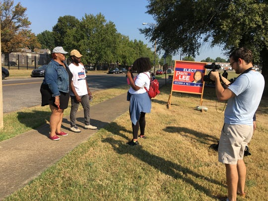 Tami Sawyer poses for a picture with campaign volunteer Joshua Adams outside Whitehaven Community Center. Sawyer says she aims to encourage volunteers who are working the polls for her on a hot day.