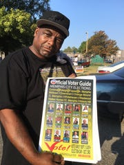 Campaign worker Dewey Jones, 58,  poses with a voters guide outside the Whitehaven Community Center on election day, Thursday, Oct. 3, 2019.