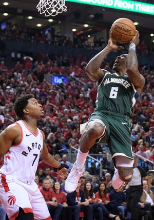 Bucks guard Eric Bledsoe shoots the ball over Raptors guard Kyle Lowry during Game 3 of the Eastern Conference finals last May.