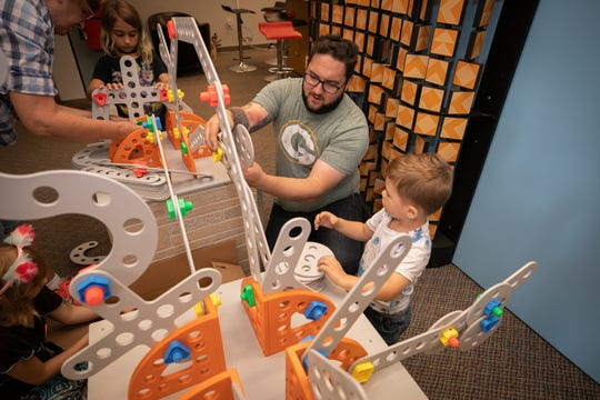 Kids and their grown-ups are invited to work together to build things in the Some Assembly Required exhibit at Betty Brinn Children's Museum.