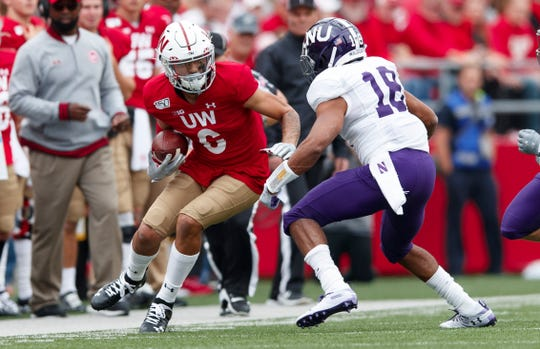 Wisconsin Badgers wide receiver Danny Davis rushes with the ball as Northwestern Wildcats defensive back Cameron Ruiz defends during their game Sep 28.