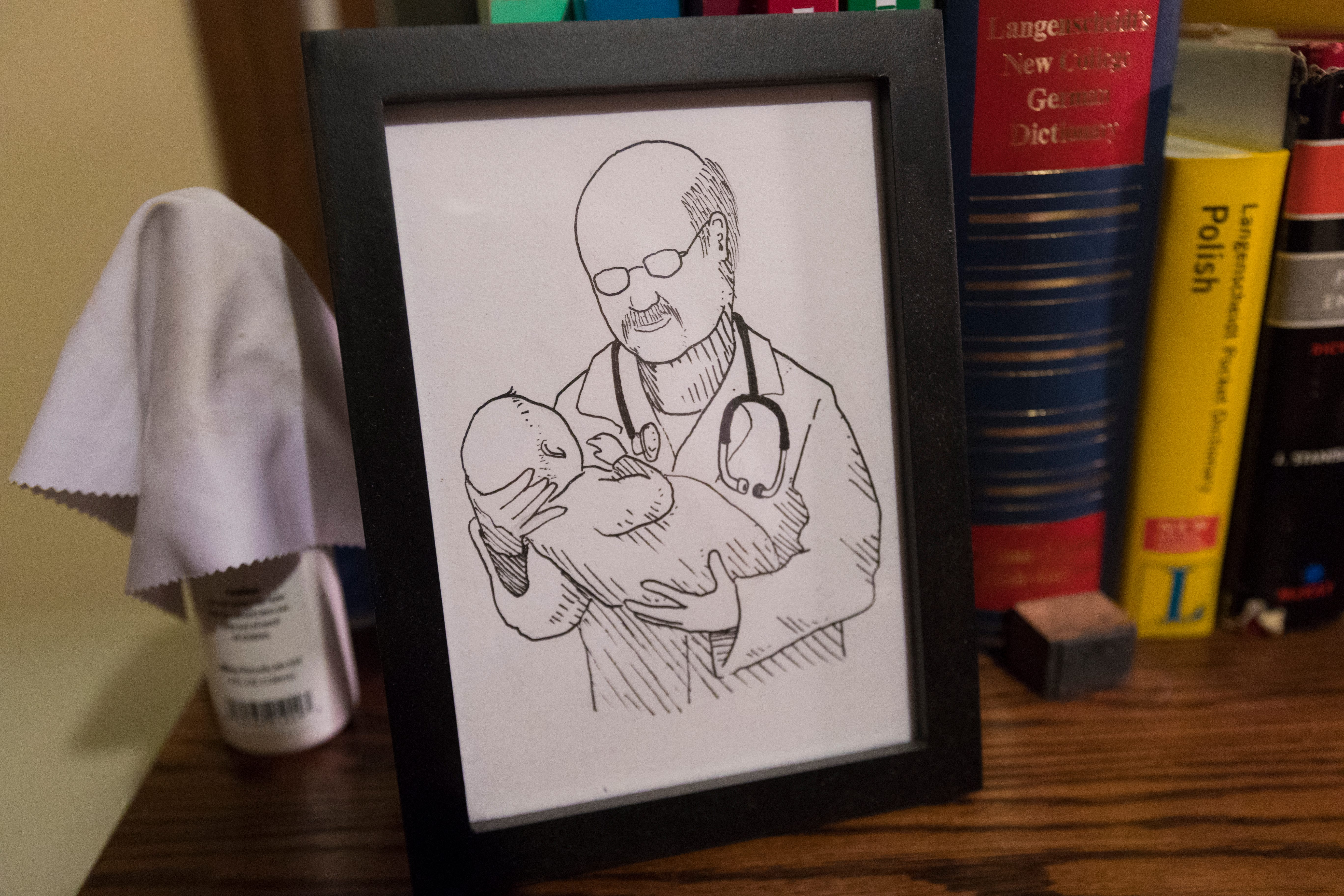 This drawing is a gift from an Amish patient. James DeLine keeps it on his desk at home.