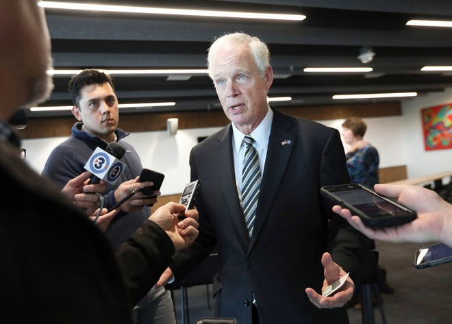 U.S. Sen. Ron Johnson, R-Wis., speaks with members of the media after meeting with the Middleton Chamber of Commerce at Serendipity Labs in Madison on Thursday. Johnson Thursday said that there was nothing wrong with President Donald Trump asking China and the Ukraine to investigate former Democratic Vice President Joe Biden and his son.