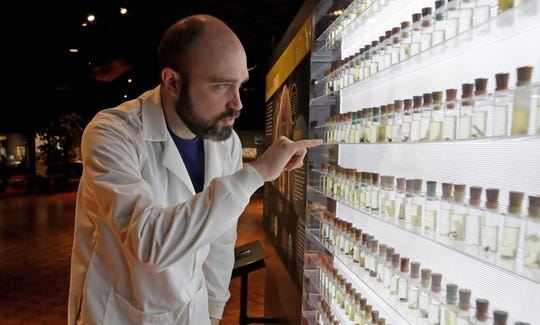 Jon Bertolas, Milwaukee Public Museum onsite curator of Spiders Alive!, talks about a display of vials of spiders preserved in alcohol in the exhibit. The display is a small sample of a larger collection on display at the American Museum of Natural History in  New York.