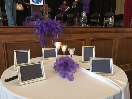 Candles serve as a reminder of victims of domestic violence.
