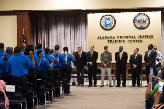 Graduates take the oath of office during the correctional officer graduation at the Alabama Criminal Justice Academy Training Center in Selma, Ala., on Thursday, Sept. 26, 2019.