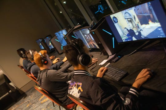 Gamers compete during an eSports tournament organized by a military-affiliated group in downtown Montgomery.