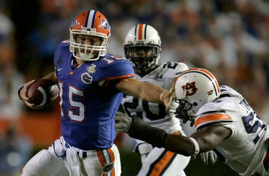 Florida quarterback Tim Tebow (15) is stopped by Auburn defenders Chris Evans (59) and Patrick Lee (20) during the teams' last meeting in Gainesville, Sept. 29, 2007.
