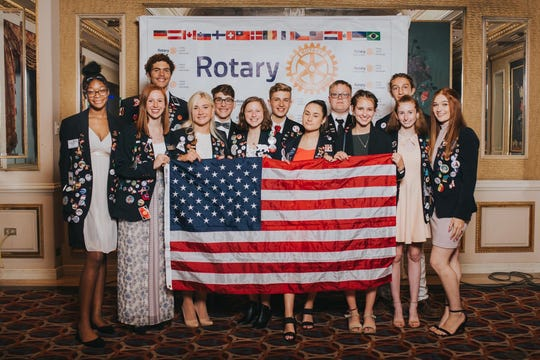 """Gracie Dale (far right), Muncie's outbound rotary youth exchange student, at the """"Night of the Blazer"""" Rotary Celebration in Lima, Peru."""