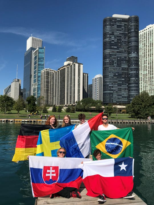 Rodrigo Krueger (top right), this year's inbound Rotary youth exchange student, holding the Brazilian flag during a trip to Chicago. Krueger will stay in Muncie for a whole school year, living with three different host families.
