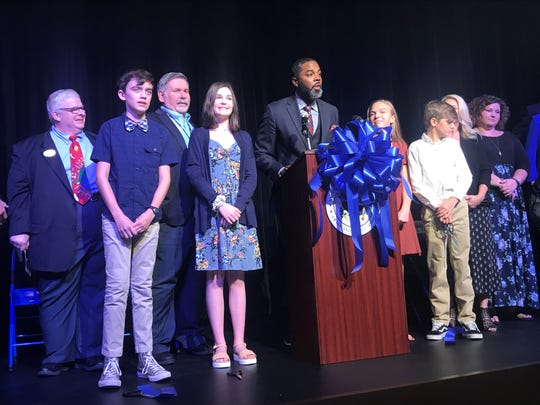 Principal Kevin Dyson led the ceremony for the grand opening of the Grassland Middle School Performing Arts Center. From left, Williamson County Commission Chairman Tommy Little, student Liam Phillips, chairman of the county school board Gary Anderson, student Melody Brooke Myers, Dyson and students and staff take the stage for the ribbon-cutting ceremony on Oct. 2, 2019.