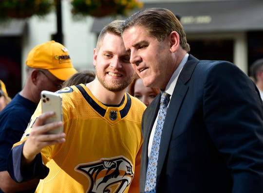 Nashville Predators fan Ryan Turner takes a selfie with head coach Peter Laviolette on the 2019 Gold Walk before the home opener at Bridgestone Arena in Nashville, Tenn., Thursday, Oct. 3, 2019.