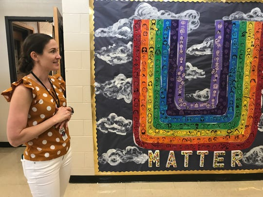 Liberty Elementary School art teacher Lauren Cochran, a member of the trauma-informed school team, talks about a student mural that builds school unity.