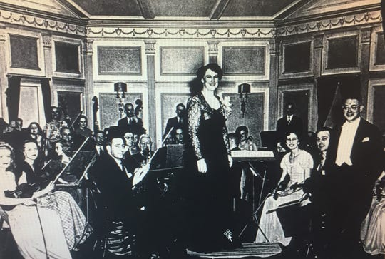 The earliest-discovered photo of the orchestra in performance, taken on the third floor of house on Hudson Avenue.