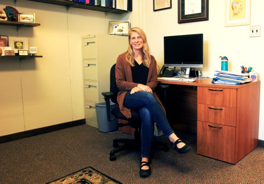 Erin Henshaw sits in her office on a Thursday morning in Denison University's psychology department.