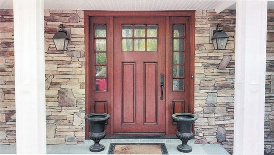 A beautiful front door, like the one above from North Jersey Door Center in Ramsey, can be made of wood, steel or fiberglass.