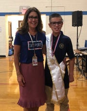 Colin Schaefer with Woodrow Wilson Principal Maureen Brown during the student council inauguration ceremony Oct. 1, 2019.